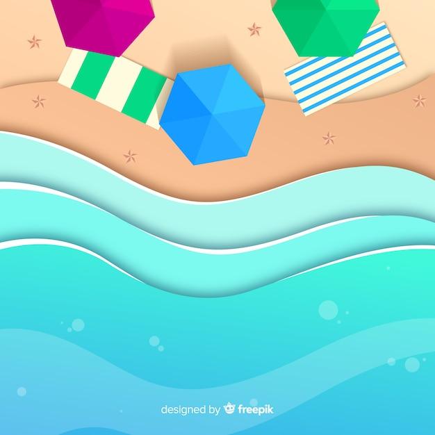 Strand bovenaanzicht in papieren stijl Gratis Vector