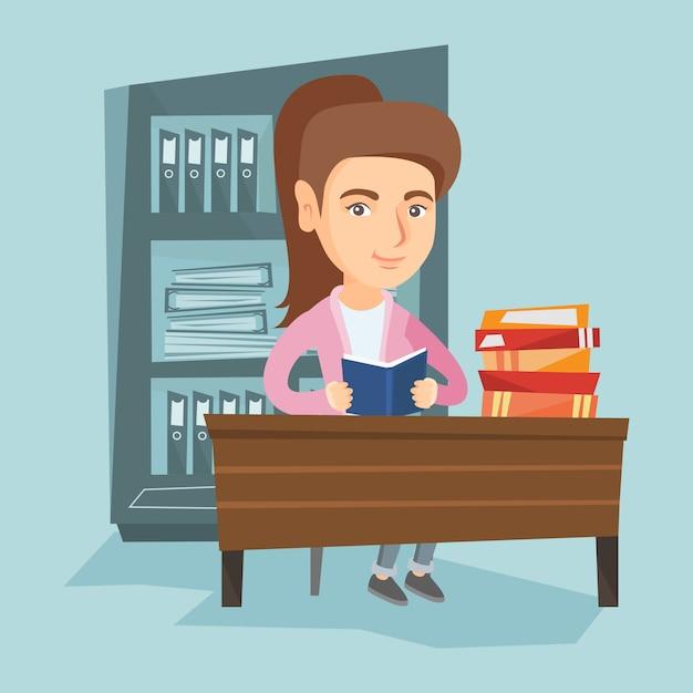Student aan tafel zitten en een boek lezen. Premium Vector