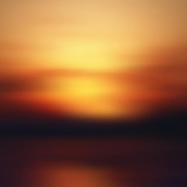 Sunset wazige achtergrond Gratis Vector