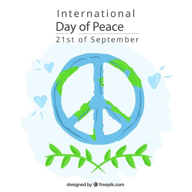 Symbool van vrede achtergrond met olijftakken en harten Gratis Vector