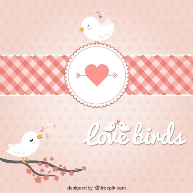 Takken vogels in harten Gratis Vector