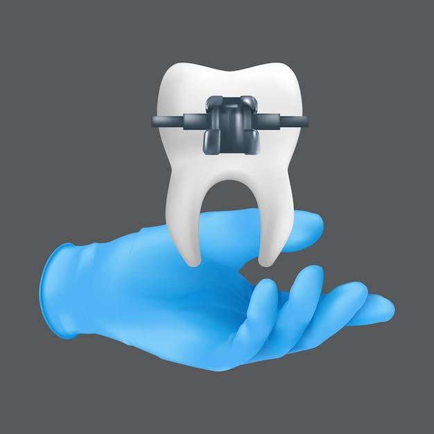 Tandartshand die blauwe chirurgische handschoen draagt die een keramisch model van de tand met metaalsteun houdt. realistische illustratie van een orthodontisch behandelingsconcept dat op een grijze achtergrond wordt geïsoleerd Premium Vector