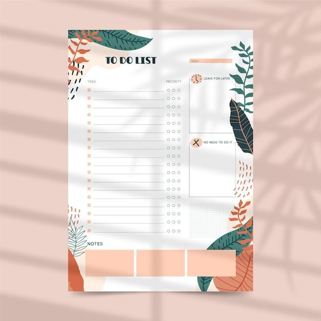 Te doen lijst planner sjabloon met bladeren Gratis Vector