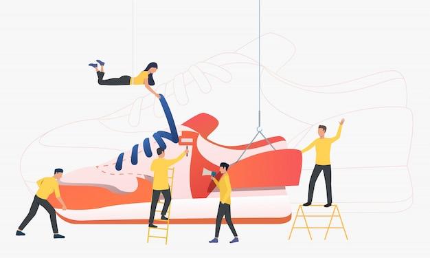Team van arbeiders die tennisschoenen produceren Gratis Vector