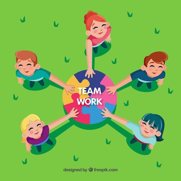 Teamwork concept met puzzelstukjes Gratis Vector