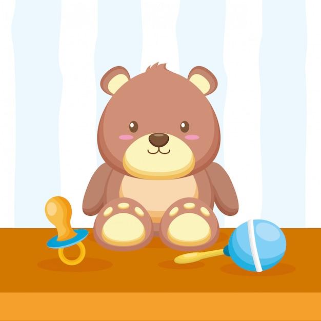 Teddybeer, maraca en fopspeen Gratis Vector