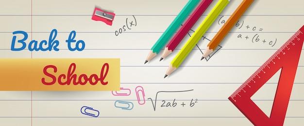 Terug naar school letters op gelinieerd papier met potloden en liniaal Gratis Vector