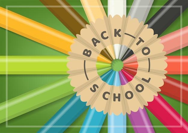 Terug naar schoolconcept met realistische veelkleurige houten kleurenpotloden in cirkelvormige uitlijning op groene achtergrond. Premium Vector