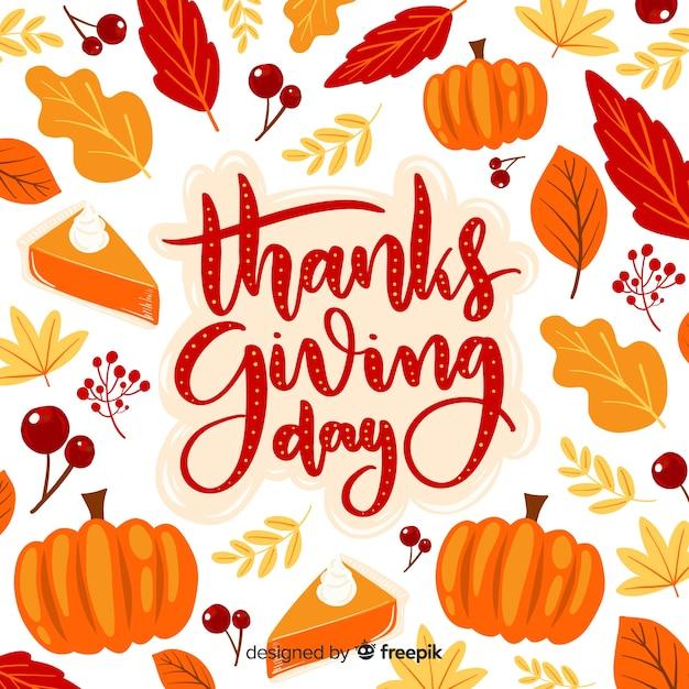 Thanksgiving day belettering achtergrond Gratis Vector
