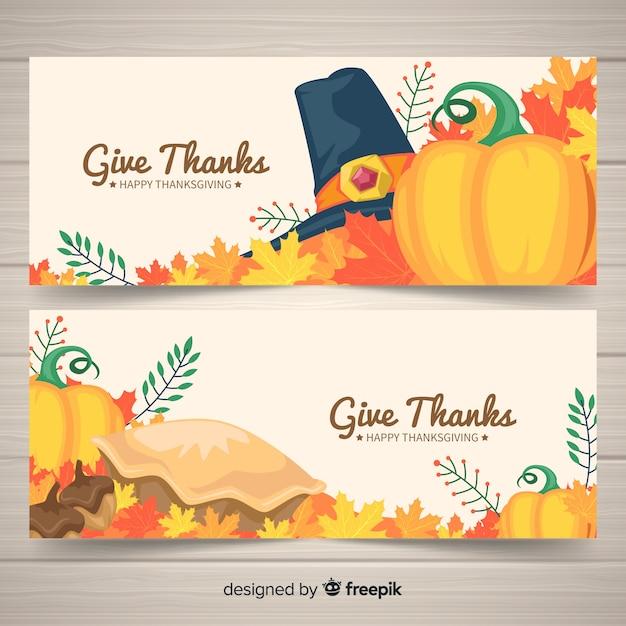 Thanksgiving daybanner die met pompoenen wordt geplaatst Gratis Vector