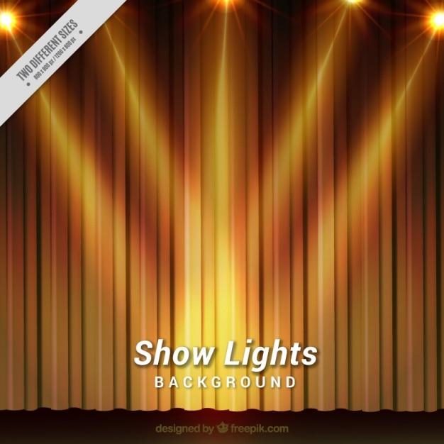 theater achtergrond met gouden gordijnen en een aantal schijnwerpers premium vector