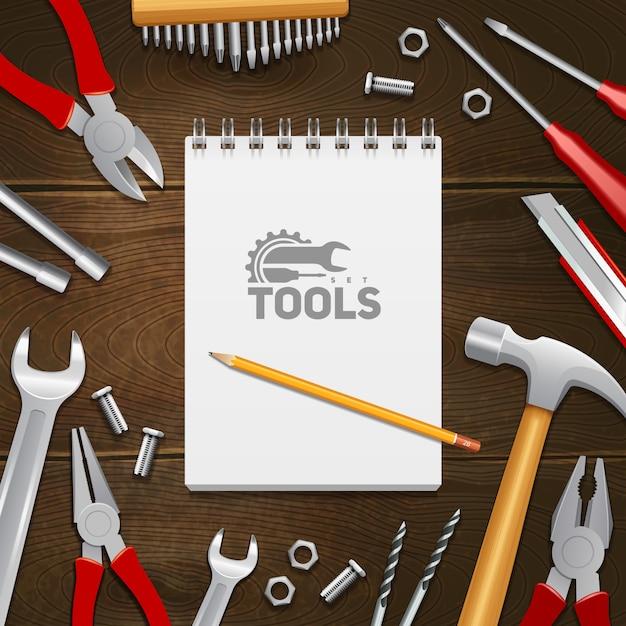 Timmerwerk bouw reparatie instrumenten tools met samenstelling van het notitieblok op donkere hout achtergrond Gratis Vector