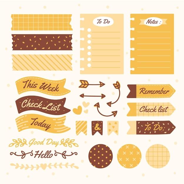 Tinten geel planner plakboek set Gratis Vector