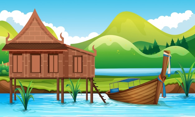 Traditioneel thais huis naast rivier Premium Vector