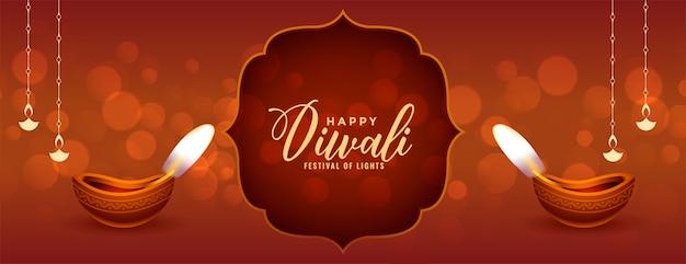 Traditionele gelukkige diwali-banner met realistische diya Gratis Vector