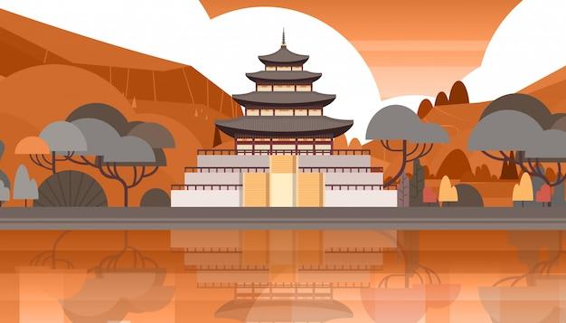 Traditionele korea tempel over bergen silhouet landschap zuid-koreaanse paleis gebouw beroemde bezienswaardigheid view Premium Vector