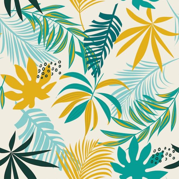 Trend naadloos tropisch patroon met kleurrijke bladeren en planten Premium Vector