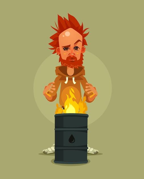 Triest ongelukkig moe dakloze man karakter verwarmt in de buurt van brandende vuilnis cartoon afbeelding Premium Vector