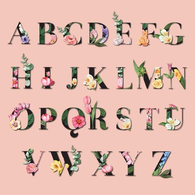 Tropische alfabet typografische zomer met serif-lettertype met planten gebladerte Gratis Vector