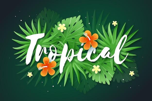 Tropische letters met bladeren Gratis Vector