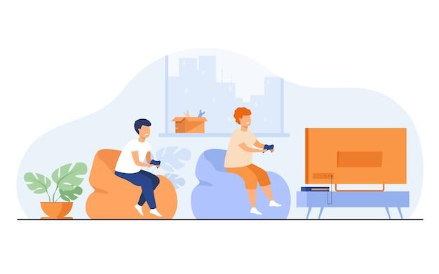 Twee gelukkige opgewonden tienerkinderen zittend op de bank bij tv met gamepads en videogame spelen. vectorillustratie met stripfiguren voor het spelen van games, jonge gamers, kinderen vrije tijd Gratis Vector