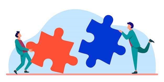 Twee mensen die puzzelstukjes met elkaar verbinden Gratis Vector