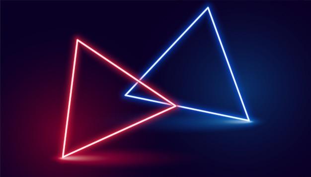 Twee neon driehoek in rode en blauwe kleuren Gratis Vector