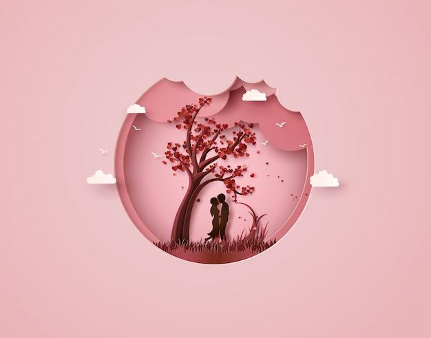 Twee verliefd onder een liefdesboom Premium Vector