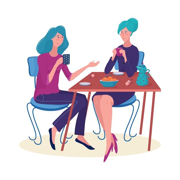 Twee vrouwen, meisjes zitten aan de tafel Premium Vector