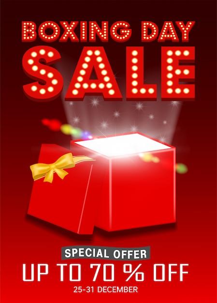 Tweede kerstdag verkoop met open geschenkdoos promoten poster Premium Vector