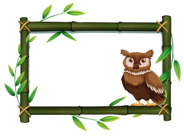 Uil in een bamboe frame Gratis Vector