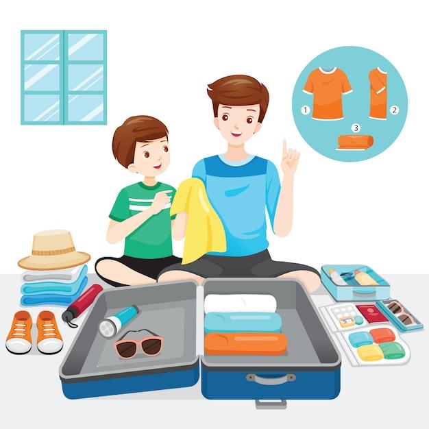 Vader die zijn zoon onderwijst om kleren en benodigdheden op bagage voor reis voor te bereiden Premium Vector