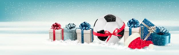 Vakantiebanner met een geschenkdozen en voetbal Premium Vector