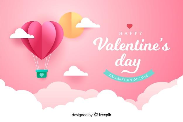 Valentijnsdag achtergrond in papier stijl Gratis Vector