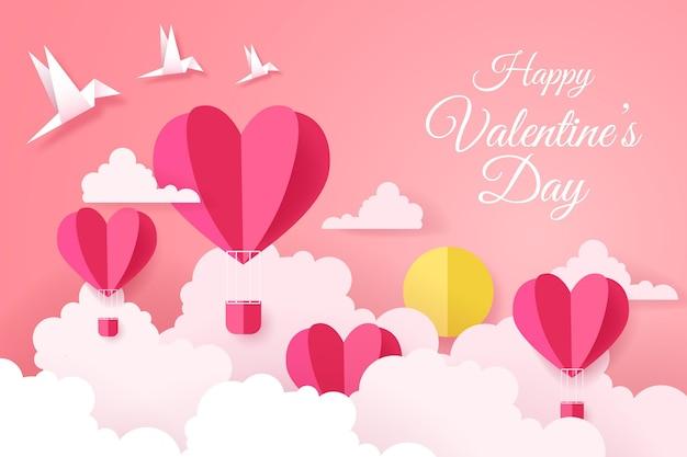 Valentijnsdag achtergrond in papieren stijl Gratis Vector