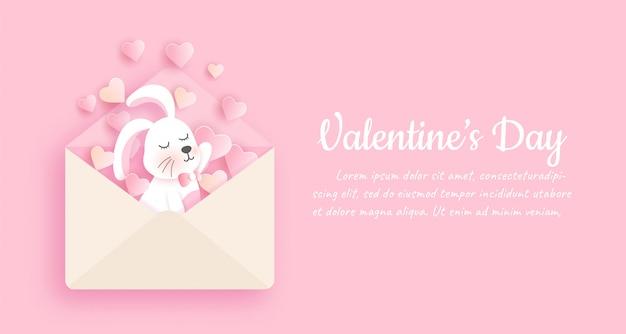 Valentijnsdag banner met schattige konijn in papier gesneden stijl Premium Vector