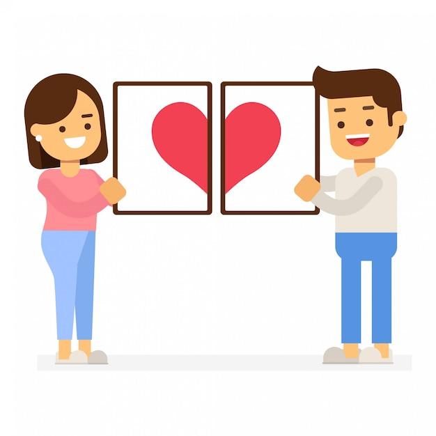 Valentijnsdag concept. paar dat rood hart in omlijstingen houdt Premium Vector