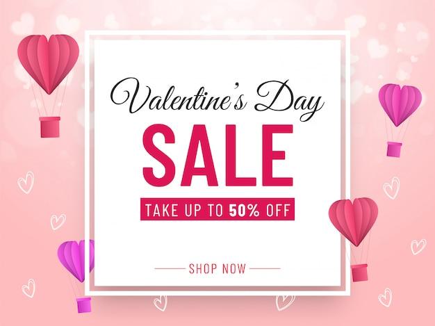 Valentijnsdag verkoop bannerontwerp met 50% kortingsaanbieding, papier gesneden luchtballonnen en harten versierd op roze achtergrond. Premium Vector