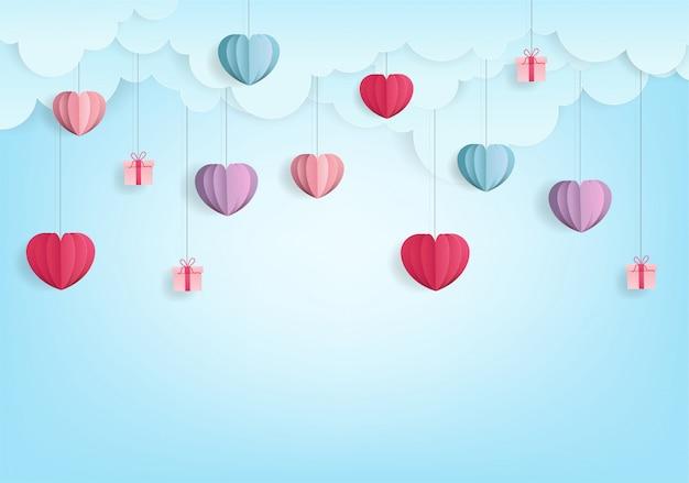 Valentine's harten ballon papier gesneden stijl abstract op blauw Premium Vector