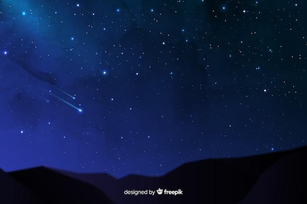 Vallende sterren op een mooie nachtachtergrond Gratis Vector