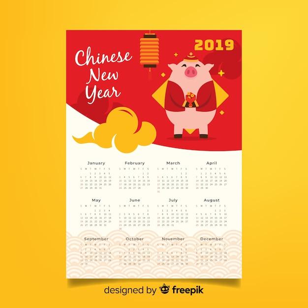 Varken met bloemen chinese nieuwe jaarkalender Gratis Vector