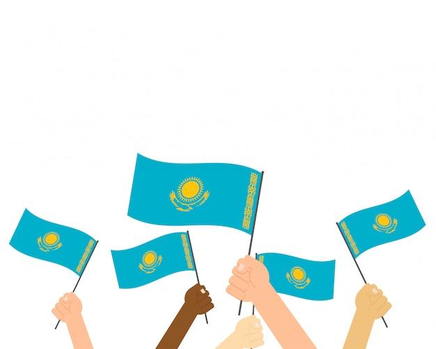 Vector illustratie die van handen de vlaggen van kazachstan houdt Premium Vector