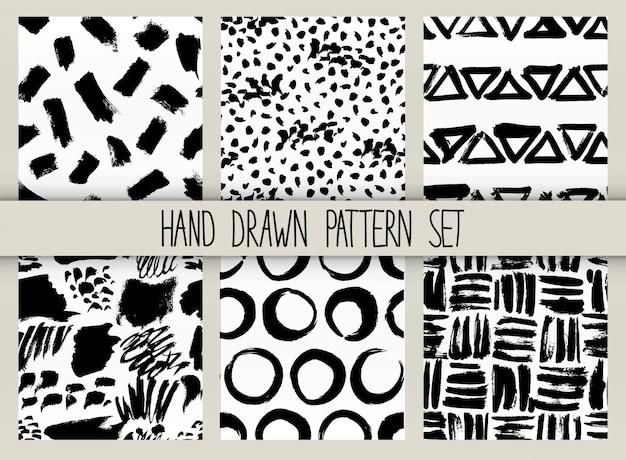 Vector naadloze patroonreeks. herhaalbare textuur met zwarte inkt getrokken lijnen collectie Premium Vector