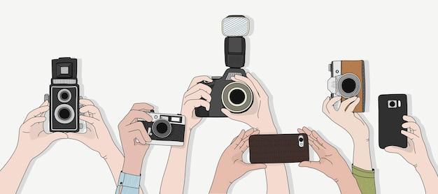 Vector van handen die foto's nemen Gratis Vector