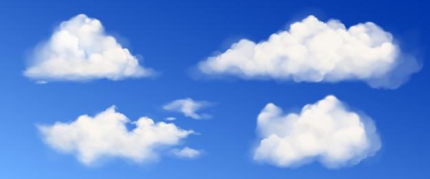 Vector witte pluizige wolken in blauwe hemel Gratis Vector