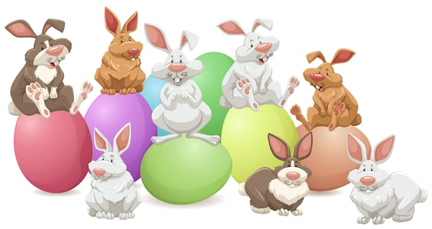 Veel konijnen op kleurrijke eieren Gratis Vector