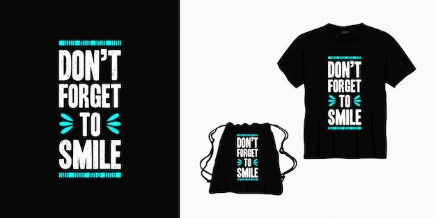 Vergeet niet om typografie belettering ontwerp te glimlachen voor t-shirt, tas of merchandise Premium Vector