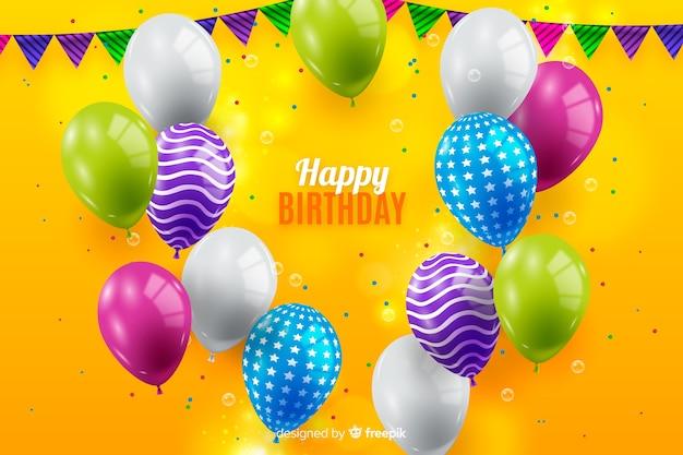 Verjaardagsachtergrond met kleurrijke ballons Gratis Vector