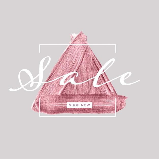 Verkoopbanner met roze gouden driehoeks geschilderde borstel op grijze achtergrond Premium Vector