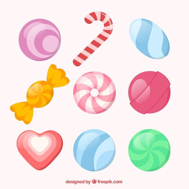 Verscheidenheid van snoepjes Gratis Vector